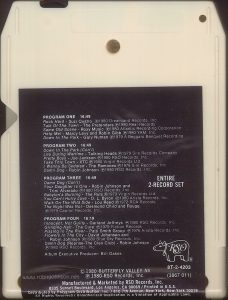 "The 8-track edition of the ""Times Square"" soundtrack split some of the songs across its programs, and lacked most of the cover art from the LP version. Text: PROGRAM ONE 16:49 Rock Hard - Suzi Quatro ℗1980 Dreamland Records, Inc. Talk Of The Town - The Pretenders ℗1980 Real Records Same Old Scene - Roxy Music ℗1980 Atlantic Recording Corporation Help Me! - Marcy levy and Robin Gibb ℗1980 YAM, Inc. Down In The Park - Gary Numan ℗1979 A Beggars Banquet Recording PROGRAM TWO 16:49 Down In The Park (Con't) Life During Wartime - Talking Heads ℗1979 Sire Records Company Pretty Boys - Joe Jackson ℗1980 RSO Records, Inc. Take This Town - XTC ℗1980 Virgin Records Ltd. I Wanna Be Sedated - The Ramones ℗1978 Sire Records, Inc. Damn Dog - Robin Johnson ℗1980 RSO Records, Inc. PROGRAM THREE 16:49 Damn Dog (Con't) Your Daughter Is One - Robin Johnson and Trini Alvarado ℗1980 RSO Records, Inc. Babylon's Burning - The Ruts ℗1979 Virgin Records Ltd. You Can't Hurry Love - D. L. Byron ℗1980 Arista Records, Inc. Walk On The Wild Side - Lou Reed ℗1972 RCA Records The Night Was Not - Desmond Child and Rouge ℗1979 Capitol Records, Inc. PROGRAM FOUR 16:19 Innocent, Not Guilty - Garland Jeffreys ℗1980 RSO Records, Inc. Grinding Halt - The Cure ℗1979 Fiction Records Pissing In The River Patti Smith Group ℗1976 Arista Records, Inc. Flowers In The City - David Johansen and Robin Johnson ℗1980 Blue Sky Records, Inc. Damn Dog (Reprise-The Cleo Club) - Robin Johnson ℗1980 RSO Records, Inc. Album Executive Producer: Bill Oakes ENTIRE 2-RECORD SET RSO ® 8T-2-4203 (3867 011) ©1980 BUTTERFLY VALLEY NV ℗1980 RSO Records, Inc. Manufactured and Marketed by RSO Records, Inc. 8335 Sunset Boulevard, Los Angeles, CA 90069 / Printed in U.S.A. Distributed by Polygram Distribution, Inc. / 810 7th Avenue, New York, New York l0019 All Rights Reserved / Unauthorized Duplication is a Violation of Applicable Laws."