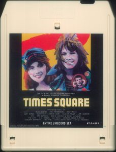 "The 8-track edition of the ""Times Square"" soundtrack split some of the songs across its programs, and lacked most of the cover art from the LP version. Text: The Original Motion Picture Soundtrack A Robert Stigwood Production TIMES SQUARE Featuring Music Of: SUZI QUATRO, THE PRETENDERS, ROXY MUSIC, GARY NUMAN, MARCY LEVY & ROBIN GIBB, TALKING HEADS, JOE JACKSON, XTC, THE RAMONES, ROBIN JOHNSON & TRINI ALVARADO, THE RUTS, D.L. BYRON, LOU REED, DESMOND CHILD & ROUGE, GARLAND JEFFREYS, THE CURE, PATTI SMITH GROUP, DAVID JOHANSEN. ENTIRE 2-RECORD SET 8T-2-4203"