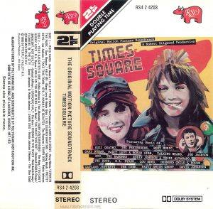 "The insert of the Canadian edition of the cassette version of the ""Times Square"" soundtrack, including the front cover, spine, and outer flap. Text: [FRONT:] 2LP DOUBLE RS4 2-4203 RSO Original Motion Picture Soundtrack A Robert Stigwood Production TIMES SQUARE Featuring Music Of: SUZI QUATRQ, THE PRETENDERS, R0XY MUSIC, GARY NUMAN, MARCY LEVY & ROBIN GIBB, TALKING HEADS, OE JACKSON, XTC, THE RAMONES, ROBIN JOHNSON & TRINI ALVARADO, THE RUTS, D.L. BYRON. LOU REED, DESMOND CHILD &, ROUGE, GARLAND JEFFREYS, THE CURE, PATTT SMITH GROUP, DAVID JOHANSEN. STEREO DOLBY SYSTEM [SPINE:] THE ORIGINAL MOTION PICTURE SOUNDTRACK TIMES SQUARE RS4 2 4203 [OUTER FLAP:] SIDE 1 - ROCK HARD -Suzi Quatro / TALK OF THE TOWN - The Pretenders / SAME OLD SCENE - Roxy Music /DOWN IN THE PARK - Gary Numan / HELP ME - Maroy Levy & Robin Gibb / LIFE DURING WARTIME - Talking Heads / PRETTY BOYS - Joe Jackson / TAKE THIS TOWN - XTC / I WANNA BE SEDATED - The Ramones / DAMN DOG - Robin Johnson SIDE 2 - YOUR DAUGHTER IS ONE - Robin Johnson & Trini Alvarado / BABYLON'S BURNING - The Ruts / YOU CAN'T HURRY LOVE - D.L. Byron / WALK ON THE WILD SIDE - Lou Reed / THE NIGHT WAS NOT - Desmond Child & Rouge / INNOCENT, NOT GUILTY - Garland Jeffreys / GRINDING HALT-The Cure/PISSING IN THE RIVER-Patti Smith Group / FLOWERS IN THE CITY - David Johansen & Robin Johnson / DAMN DOG - Robin Johnson (Reprise - The Cleo Club) ℗1980 MULTIPLIER N.V. ©1980 BUTTERFLY VALLEY N.V. MANUFACTURED BY POLYGRAM INC. AND DISTRIBUTED BY POLYGRAM DISTRIBUTION INC. 6000 COTE DE LIESSE. ST LAURENT, QUEBEC H4T 1E3 Stereo also playable mono."