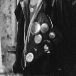 "Detail showing the buttons on the left lapel of the leather jacket worn by Trini Alvarado as Pammy, from a ublicity still of Robin Johnson and Trini Alvarado in the ""hideout"" in Pier 56 from the ""Times Square"" US Press Materials folder."