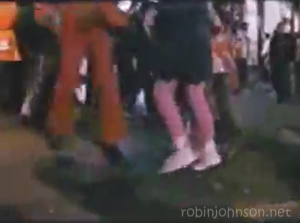 The feet of Pammy and the man in the red suit, from a shot from the TIMES SQUARE soundtrack promotional video not in the movie.