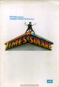 "The UK press kit had its own logo, a black-and-white Nicky atop a color theater marquee made of the words ""Times Square"".  Text:  EMI FILMS presents A ROBERT STIGWOOD Producton TIMES SQUARE EMI"