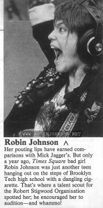 Detail from third page of an article about new celebrities of 1980.  Text:  Robin Johnson  Her pouting lips have earned comparisons with Mick Jagger's. But only a year ago, Times Square bad girl Robin Johnson was just another teen hanging out on the steps of Brooklyn Tech high school with a dangling cigarette. That's where a talent scout for the Robert Stigwood Organisation spotted her; he encouraged her to audition—and whammo!
