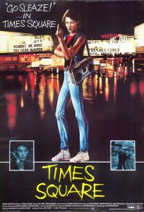 """Times Square"" UK movie poster, featuring a painting by Cummins of Nicky over a collage of Times Square theater marquees Text: ""GO SLEAZE!"" ...IN TIMES SQUARE CUMMINS TIMES SQUARE ROBERT STIGWOOD Presents ""TIMES SQUARE"" Starring TIM CURRY·TRINI ALVARADO And Introducing ROBIN JOHNSON Also Starring PETER COFFIELD·HERBERT BERGHOF·DAVID MARGULIES·ANNA MARIA HORSFORD Executive Producers KEVIN McCORMICK·JOHN NICOLELLA Directed by ALAN MOYLE Produced by ROBERT STIGWOOD and JACOB BRACKMAN Screenplay by JACOB BRACKMAN Story by ALAN MOYLE and LEANNE UNGER Associate Producer BILL OAKES An EMI-ITC Production Soundtrack available on RSO Records and TAPES RSO Distributed by EMI Films Limited. EMI A Member of the THORN EMI Group. PRINTED IN ENGLAND BY W. E. BERRY LTD. BRADFORD"
