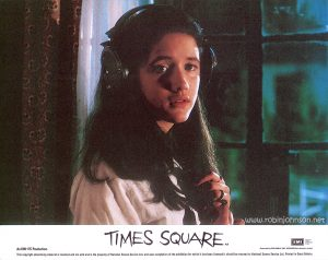 "Trini Alvarado as Pamela Pearl: Color 8""x10"" lobby card, 1981  Text:  TIMES SQUARE AA Released by COLUMBIA - EMI - WARNER Distributors Limited. EMI A Member of the THORN EMI Group An EMI-ITC Production This copyright advertising material is licensed and not sold and is the property of National Screen Service Ltd. and upon completion of the exhibition for which it has been licensed it should be returned to National Screen Service Ltd. Printed in Great Britain."