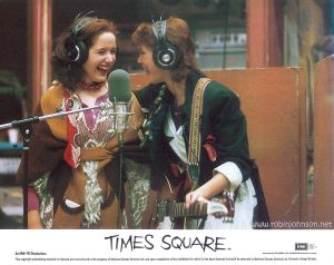 "Color 8""x10"" lobby card, 1981 Text: TIMES SQUARE AA Released by COLUMBIA - EMI - WARNER Distributors Limited. EMI A Member of the THORN EMI Group An EMI-ITC Production This copyright advertising material is licensed and not sold and is the property of National Screen Service Ltd. and upon completion of the exhibition for which it has been licensed it should be returned to National Screen Service Ltd. Printed in Great Britain."