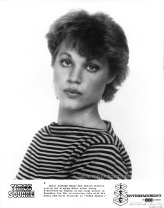 "Inscription:  TIMES SQUARE  4  Robin Johnson makes her motion picture acting and singing debut after being discovered by chance at her high school in Brooklyn for the co-starring role with Tim Curry and Trini Alvarado in ""Times Square.""  ITC ENTERTAINMENT  AN acc COMPANY  Permission is hereby granted to newspapers and other periodicals to reproduce this photograph for publicity or advertising except for the endorsement of products. This must not be sold leased or given away  Printed in USA"