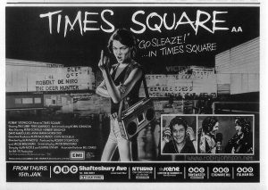 "UK magazine ad for ""Times Square"", 1981 Text: TIMES SQUARE AA  ""GO SLEAZE!"" ...IN TIMES SQUARE  ROBERT STIGWOOD Presents ""TIMES SQUARE""  Starring TIM CURRY·TRINI ALVARADO And Introducing ROBIN JOHNSON  Also Starring PETER COFFIELD·HERBERT BERGHOF DAVID MARGULIES·ANNA MARIA HORSFORD  Executive Producers KEVIN McCORMICK·JOHN NICOLELLA  Directed by ALAN MOYLE  Produced by ROBERT STIGWOOD and JACOB BRACKMAN Screenplay by JACOB BRACKMAN  Story by ALAN MOYLE and LEANNE UNGER  Associate Producer BILL OAKES An EMI-ITC Production  Soundtrack available on RSO Records and TAPES RSO  Released by COLUMBIA-EMI-WARNER Distributors Limited.  EMI  A Member of the THORN EMI Group. FROM THURS. 15 JAN. ABC  Shaftesbury Ave  Tel: 836 8861  Licensed Bar  DOLBY STEREO  STUDIO  OXFORD CIRCUS  Tel: 437 3300  DOLBY STEREO  SCENE LEICESTER SQ (WARDOUR ST)  Tel.439.4470  ABC  BAYSWATER  DOLBY STEREO  ABC  EDGWARE RD.  ABC  FULHAM RD."