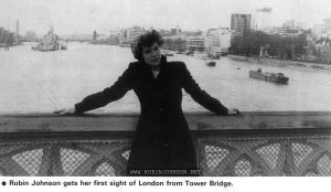 """The first photo accompanying the article/ advertisement 'Robin: a new star in """"Times Square""""' from Screen International No 276, January 24, 1981, p. 23.  Text:   Robin Johnson gets her first sight of London from Tower Bridge."""