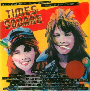 "Peruvian edition of the soundtrack album to ""Times Square"" (1980), front cover. Text: The Original Motion Picture Soundtrack A Robert Stigwood Production TIMES SQUARE Featuring Music Of: SUZI QUATRQ, THE PRETENDERS, R0XY MUSIC, GARY NUMAN, MARCY LEVY & ROBIN GIBB, TALKING HEADS, JOE JACKSON, XTC, THE RAMONES, ROBIN JOHNSON & TRINI ALVARADO, THE RUTS, D.L. BYRON, LOU REED, DESMOND CHILD &, ROUGE, GARLAND JEFFREYS, THE CURE, PATTI SMITH GROUP, DAVID JOHANSEN."