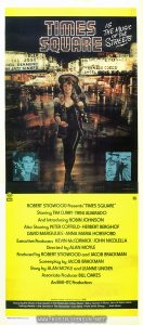 "Small movie poster for TIMES SQUARE featuring a Mick Rock photo of Robin Johnson. Text: TIMES SQUARE IS THE MUSIC OF THE STREETS TIM CURRY © 1980 Butterfly Valley N.V. GD FILM DISTRIBUTORS EMI M ROBERT STIGWOOD Presents ""TIMES SQUARE""  Starring TIM CURRY • TRINI ALVARADO  And Introducing ROBIN JOHNSON  Also Starring PETER COFFIELD • HERBERT BERGHOF  DAVID MARGUUES • ANNA MARIA HORSFORD  Executive Producers KEVIN McCORMICK • JOHN NICOLELLA  Directed by ALAN MOYLE Produced by ROBERT STIGWOOD and JACOB BRACKMAN  Screenplay by JACOB BRACKMAN  Story by ALAN MOYLE and LEANNE UNGER  Associate Producer BILL OAKES  An EMI-ITC Production Soundtrack available on RSO Records and Tapes RSO Featuring the Music of Suzi Quatro • The Pretenders • Roxy Music • Gary Numan • Marcy Levy & Robin Gibb  Talking Heads • Joe Jackson • The Ramones • Lou Reed • Patti Smith Group ... And More! Robert Burton Printers Pty."