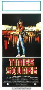 """Italian movie poster  Text:  TIMES SQUARE ROBERT STIGWOOD presenta """"TIMES SQUARE"""" con TIM CURRY* TRINI ALVARADO • e per la prima volta sullo schermo ROBIN JOHNSON con PETER COFFIELD • HERBERT BERGHOF • DAVID MARGULIES • ANNA MARIA HORSFORD produttori esecutivi KEVIN McCORMICK e JOHN NICOLELLA diretto da ALAN MOYLE prodotto da ROBERT STIGWOOD e JACOB BRACKMAN sceneggiatura di JACOB BRACKMAN soggetto di ALAN MOYLE e LEANNE UNGER produttore associato BILL OAKES una produzione EMI - ITC IDIF Technicolor • STEREOFUTURSOUND Selegrafica 80-Roma"""