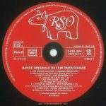 Times Square soundtrack album, France, side 2 label Text: TOUS DROITS DU PRODUCTEUR PHONOGRAPHIQUE ET DU PROPRIETAIRE DE L'ŒUVRE ENREGISTREE RESERVES, SAUF AUTORISATION, LA DUPLICATION, LA LOCATION, LE PRET, L'UTILISATION DE CE DISQUE POUR EXECUTION PUBLIQUE ET RADIODIFFUSION SONT INTERDITS. FABRIQUE EN FRANCE RSO DISTRIBUTION EXCLUSIVE POLYDOR S.A. Face 2 SACEM SACD SDRM SGDL ℗ 1980 RSO ALBUM No 2658 145 2479 264 2479 264 2 GU 33 DISQUE 1 BANDE ORIGINALE DU FILM TIMES SQUARE 1. LIFE DURING WARTIME - TALKING HEADS 3'40 (D. Byrne) Ed. Index Mus/Bleu Disque Mus. Co. Inc. 2. PRETTY BOYS - JOE JACKSON 3'21 (J. Jackson) Ed. ALbion Mus. Ltd. 3. TAKE THIS TOWN - XTC 4'07 (A. Partridge) Ed. Nymph Mus. 4. I WANNA BE SEDATED - THE RAMONES 2'29 (The Ramones) Ed. Bleu Disque Mus. Co. Inc./Taco Tunes Inc. 5. DAMN DOG - ROBIN JOHNSON 2'40 (B. Mernit-J. Brackman) Ed. Stigwood Mus. Inc. Producteur exécutif de l'album: Bill Oakes