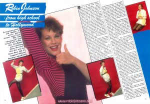 "An article about Robin in the Australian magazine Dolly (#128, June 1981).  This is pages 56 & 57, containing four color photographs not published elsewhere.  Text:  Robin Johnson - from high school to Hollywood  Seventeen-year-old Robin is every girl's dream come true ... She was ""discovered"" and turned into a star. One day Robin was watching films, the next day she was in them. How did it happen? Alison Gardner asked her  Bnow, 17-year-old Robin Johnson, star of the film Times Square, should need no introduction ... Even if you haven't seen the film yet, you can't possibly have missed all of the press coverage Robin received when she visited Australia a few months ago. Robin was big news in all of the papers, who were keen to tell her story and, on TV talk shows, where Robin was invited for a chat, interviewers couldn't get a word in edgeways as she recounted her rise to stardom. You see, it wasn't so much Robin's part in Times Square that everyone was interested in but how she got the part in the first place. Before Times Square, Robin had never acted in her life, not even in a school play. Now she has a three-film contract with the Robert Stigwood Organisation in America and her second film — due to start shooting later this year — is the follow-up to Grease. Robin has the female lead part opposite Andy Gibb. Stories of shy young girls being plucked from the streets and made into Hollywood stars have filled reels and reels of film but Robin's discovery — which would make a great film itself — isn't quite so saccharine-sweet. To begin with, Robin is not shy — as I soon found out when I met her. I am not the first journalist to comment on Robin's ability to talk ... and talk ... and talk, seemingly without ever pausing for breath. Robin herself knows she talks a lot but shrugs it off as if to say ""So what? It's no crime"". It certainly isn't a crime, not if you talk like Robin Johnson. Oh, her English isn't perfect but then, if you lived in Brooklyn (New YYork) yours wouldn't be, either. Her voice is deep and a bit hoarse and her hands fly everywhere as she speaks, which made it necessary for me to sit well away from her as we talked. But Robin is a rare species from the acting world because she is in¬teresting to talk to and totally unin¬hibited; she is witty, intelligent, cheeky, polite and great fun. She seemed to treat her sudden fame a bit like a new toy and she was having great fun playing with it ... Travelling around the world to promote Times Square gave Robin great joy and she was ready and willing to answer any questions I asked her. So, first off, how did she — a high school kid whose closest contact with showbiz was as part of the audience at the movies — get the part of the rough-and-ready Nicky Marotta? ""Well, it's very conveniently Hollywood,"" Robin said, sounding almost disgusted with this fact. ""I was literally discovered on the steps of my high school by a talent-scout. ""I was standing outside the school with a friend and I heard this guy say to me: 'Would you be about 16?' I said: 'You talking to me?' I mean, what a way to approach someone! There are not too many things that are weird for New York but that's weird. ""Anyway, he asked me again if I was about 16 and when I told him I was, he told me about this advertisement that was in a paper called The Village Voice for auditions for the film, Times Square. He said he thought I would be right for the part of Nicky Marotta. At first I thought the guy was a nut but he talked in detail about the film for an hour and I figured he couldn't be making it all up. ""In the end, he gave me a card with a phone number on it and said if I was interested I was to phone the following Monday and ask to speak to Jake — who turned out to be the producer and screen-writer."" Robin hasn't seen the guy who ""discovered"" her, since. She later found out that he wasn't connected with the casting for Times Square. ""He hasn't even come asking for his 10 per cent fee and I'm surprised about that,"" Robin said. Anyway, Robin called the number that Monday and her life has never been the same since. ""Before this I had never thought about acting as a career,"" Robin told me. ""Maybe in a wild thought, like 'Gee, it would be nice to be an actress' but never seriously. Me? In a movie? You've got to be kidding. ►"