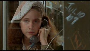 Pammy calls her father; frame from TIMES SQUARE (1980)