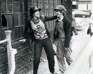 "One of a series of black and white 8x10"" photos distributed in the UK in 1981 to promote TIMES SQUARE (1980). Caption on back: 13. Nicky (ROBIN JOHNSON) and Pamela (TRINI ALVARADO). A scene from ""TIMES SQUARE"" distributed by COLUMBIA/EMI/WARNER Film Distributors."