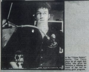 "Photo of Tim Curry in an Australian music newspaper weekly containing several stories relating to TIMES SQUARE (1980).  Caption:  In the ""Times Square"" movie, Tim Curry plays an all night disc jockey who gives his listeners a  running account of the two runaway girls' progress."