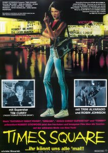 "1982 German movie poster for TIMES SQUARE (1980).  Text:  ROBERT STIGWOOD Presents ""TIME SQUARE""  Starring TIM CURRY • TRINI ALVARADO • ROBIN  JOHNSON • PETER COFFIELD • HERBERT  BERGHOF • DAVID MARGULIES • ANNA MARIA  HORSFORD  Executive Producers KEVIN McCORMICK  JOHN NICOLELLA • Directed by ALAN MOYLE  Produced by ROBERT STIGWOOD and JACOB  BRACKMAN • Screenplay by JACOB BRACKMAN  Story by ALAN MOYLE and LEANNE UNGER  Associate Producer BILL OAKES  An EMI-ITC Production  Soundtrack erschienen auf dem RSO-Label bei der  DEUTSCHEN GRAMMOPHON GmbH  mit Superstar TIM CURRY (""ROCKY HORROR PICTURE SHOW"")  mit TRINI ALVARADO  und ROBIN JOHNSON  Nach ""SATURDAY NIGHT FEVER"", ""GREASE"", ""JESUS CHRIST SUPERSTAR"" und ""TOMMY""  präsentiert ROBERT STIGWOOD jetzt den frechsten und fetzigsten Film über die Teenies auf der wildesten Meile von New York!  TIMES SQUARE ...ihr könnt uns alle 'mal!!  schröder-filmverleih  DOLBY STEREO    FSK FREIGEGEBEN  [Translation:]  Soundtrack from RSO appears on DEUTSCHEN GRAMMOPHON GmbH  with superstar TIM CURRY  (""ROCKY HORROR PICTURE SHOW"")  with TRINI ALVARADO and ROBIN JOHNSON  After ""SATURDAY NIGHT FEVER"", ""GREASE"", ""JESUS CHRIST SUPERSTAR"" and ""TOMMY"" ROBERT STIGWOOD now presents the sassiest and craziest movie about teens on the wildest mile of New York!  TIMES SQUARE ... you can all [kiss our asses]!  schröder-film distributors  DOLBY STEREO    FSK RELEASED"