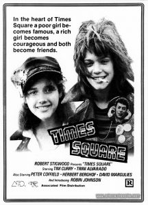 "Positive made from negative of newspaper ad for TIMES SQUARE (1980). Text: In the heart of Times Square a poor girl be- comes famous, a rich girl beomes courageous and both become friends. TIMES SQUARE ROBERT STIGWOOD Presents ""TIMES SQUARE"" Starring TIM CURRY · TRINI ALVARADO Also Starring PETER COFFIELD · HERBERT BERGHOF · DAVID MARGULIES And Introducing ROBIN JOHNSON AFD™ RSO® Associated Film Distribution R"
