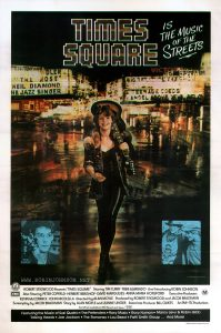 "Photo by Mick Rock of Robin Johnson as Nicky overlaid on a city street collage  Text:  TIMES SQUARE  IS THE MUSIC OF THE STREETS  TIM CURRY  © 1980 Butterfly Valley N.V.  GD FILM DISTRIBUTORS EMI  ROBERT STIGWOOD Presents""TIMES SQUARE"" Starring TIM CURRY • TRINI ALVARADO  And Introducing ROBIN JOHNSON  Also Starring PETER COFFIELD • HERBERT BERGHOF • DAVID MARGULIES • ANNA MARIA HORSFORD  Executive Producers KEVIN McCORMICK • JOHN NICOLELLA  Directed by ALAN MOYLE  Produced by ROBERT STIGWOOD and JACOB BRACKMAN  Screenplay by JACOB BRACKMAN  Story by ALAN MOYLE and LEANNE UNGER  Associate Producer BILL OAKES  An EMI-ITC Production  M  Soundtrack available on RSO Records and Tapes  Featuring the Music of Suzi Quatro • The Pretenders • Roxy Music • Gary Numan • Marcy Levy & Robin Gibb  Talking Heads • Joe Jackson • The Ramones • Lou Reed • Patti Smith Group ...  And More!  Robert Burton Printers Pty. Ltd."