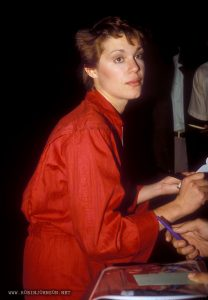 Robin Johnson signing autographs, approximately late 1980