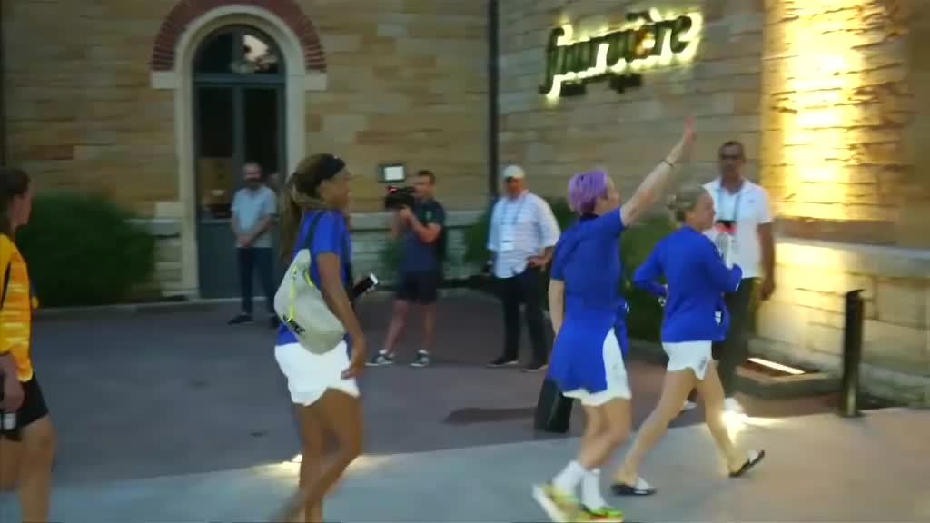 Victorious USA players arrive back at hotel