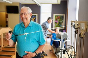 Senior resident exercising at Rolling Green Village