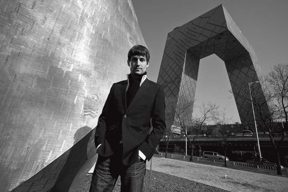Architect Ole  Scheeren standing outside of the CCTV building in Beijing