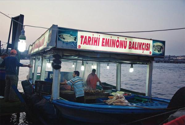 Tarihi Eminönü Balıkçısı fishing boat, Istanbul that sells delicious fish sandwiches.