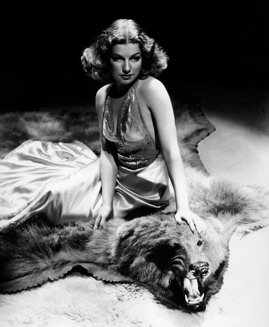 Ann Sheridan sat atop a bear skin, circa 1939-41