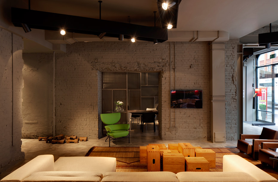 Cassina-London interior, bare painted brick walls, lighting and open-plan spacing