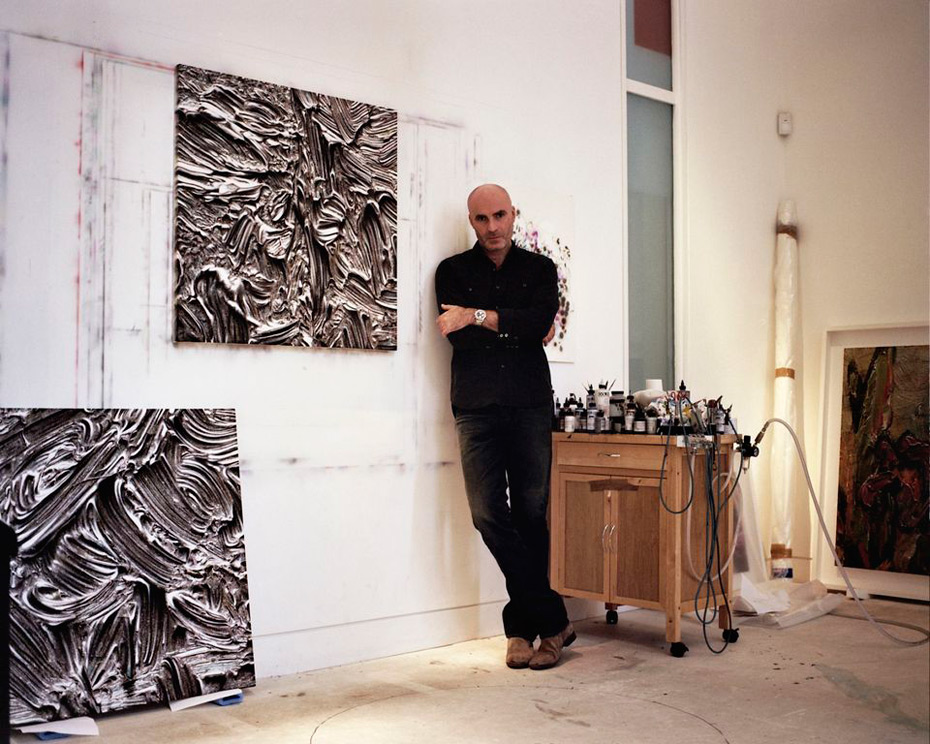 Jason-Brooks-in-front-of-his-paintings,-studio