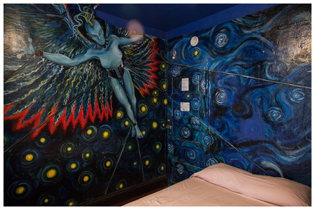 blue corseted and winged-creature mural