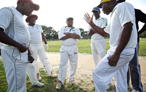 The Progressive Cricket Club discusses strategy one Sunday during a game at Marine Park in Brooklyn.