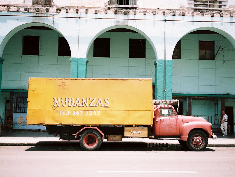 Orange Mudanzas truck in central Havana