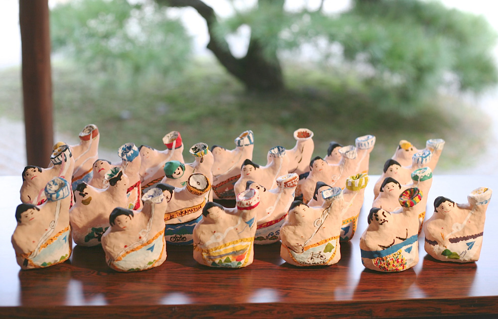 Sumo wrestler ornaments made by the group during a visit to Takamatsu
