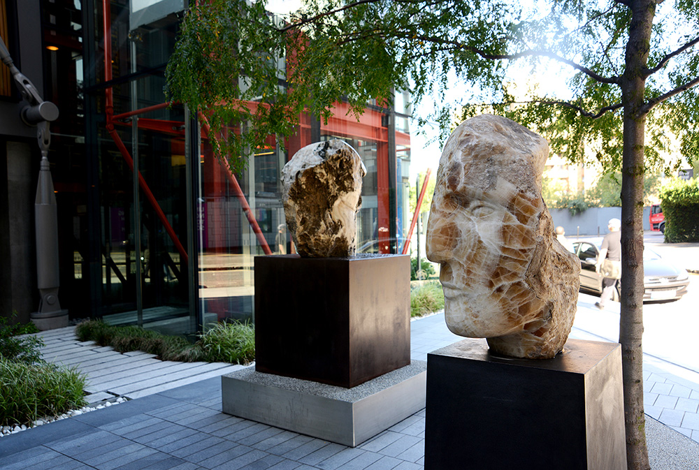 Emily Young, Mont Amiata Warrior, clastic igneous rock in situ at NEO Bankside, 51x41x47 cm, 2012. © Emily Young, courtesy of The Fine Art Society.