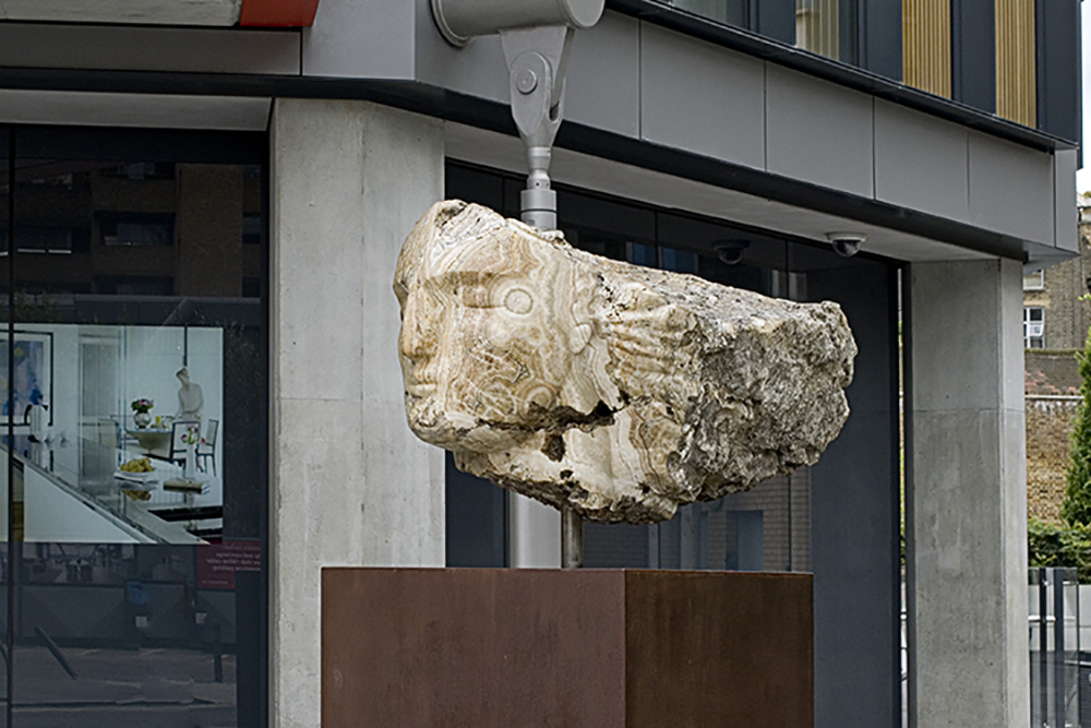Emily Young, Tempesta (Etruscan goddess of the wind), 90x116x178 cm, 2012, in situ at NEO Bankside. © Emily Young, courtesy of The Fine Art Society