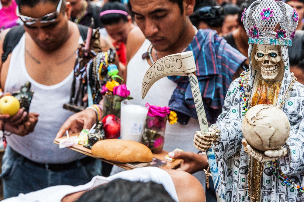 Santa Muerte devotees say prayers to the 'Skinny Lady' at the largest Santa Muerte service of the year in Mexico City