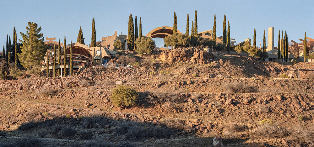 Perched on the edge of a south-facing mesa in central Arizona, more than 7,000 people from around the world have come to build and inhabit the buildings since it was founded in 1970