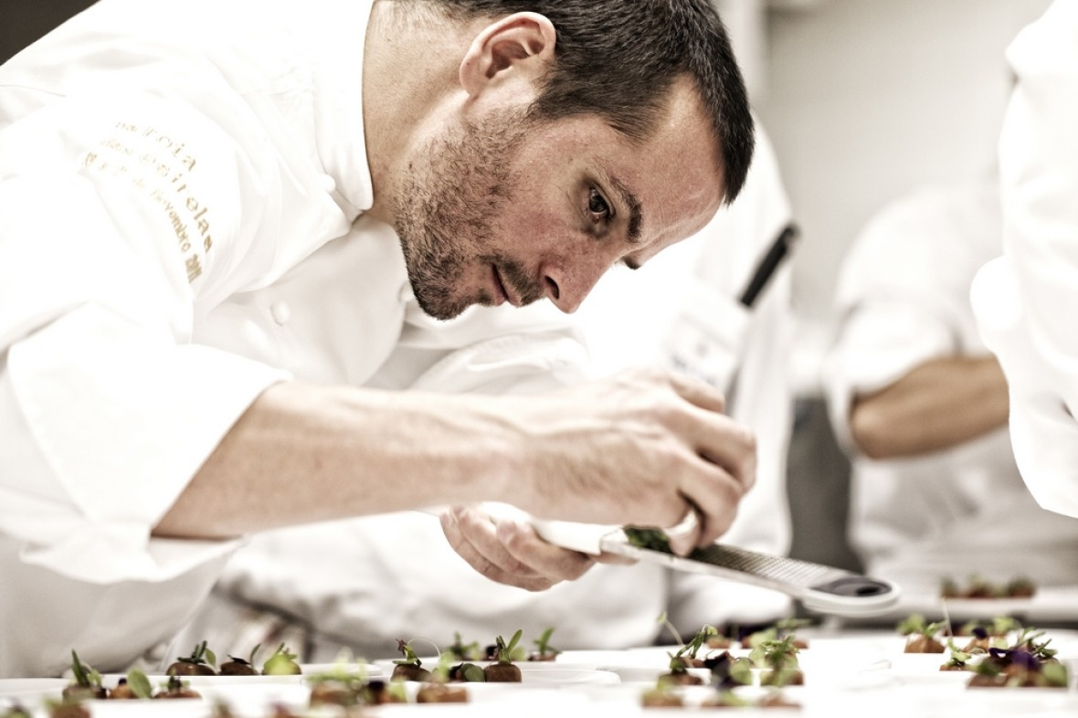 Hans Neuner preparing food in the Michelin-starred Fortaleza do Guincho during 'Night of the Stars' culinary tour – photo: Guerrilla Food Photography