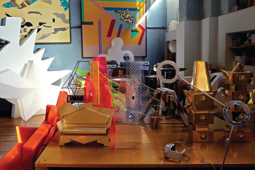 Atelier Mending is filled with colourful products and prototypes, including the Amuleto lamp in the foreground and the plastic K2 Loveseat for A Lot Of Brasil on the left.