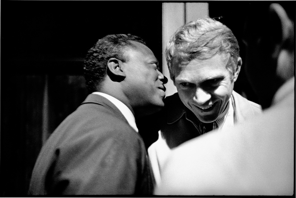 Miles Davis in conversation with actor Steve McQueen, backstage at the 1963 Monterey jazz festival. Photograph: © Jim Marshall Photography LLC / Reel Art Press
