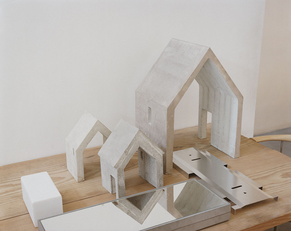 Study models and prototypes on a table in Pawson's studio