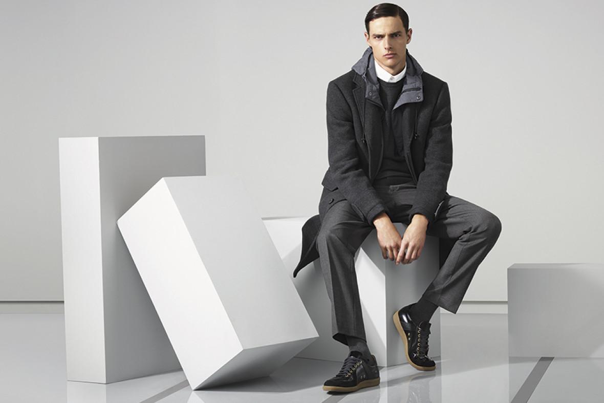 Plain stretch shirt, colour block crew neck jumper, boucle coat, formal flat front trouser, leather trainers