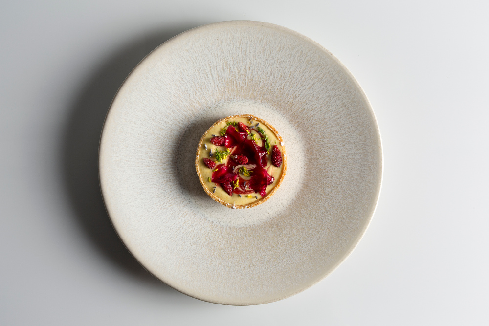 Wild strawberry tartlet with camomile & rose petals – photo by Joakim Blockstrom