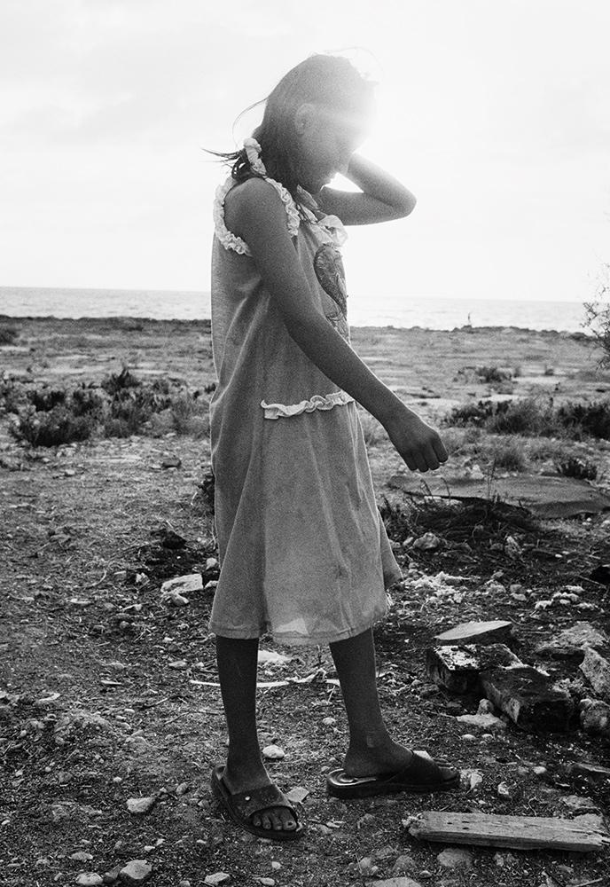 Khawla, 12 years old, at the makeshift camp where she lives near Tripoli, Lebanon. September 2014