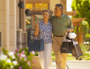 two seniors shopping at outdoor mall