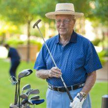elderly man golfing