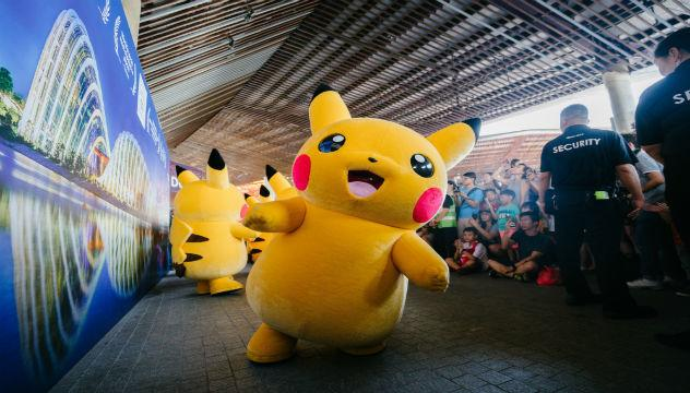 people in pikachu costumes